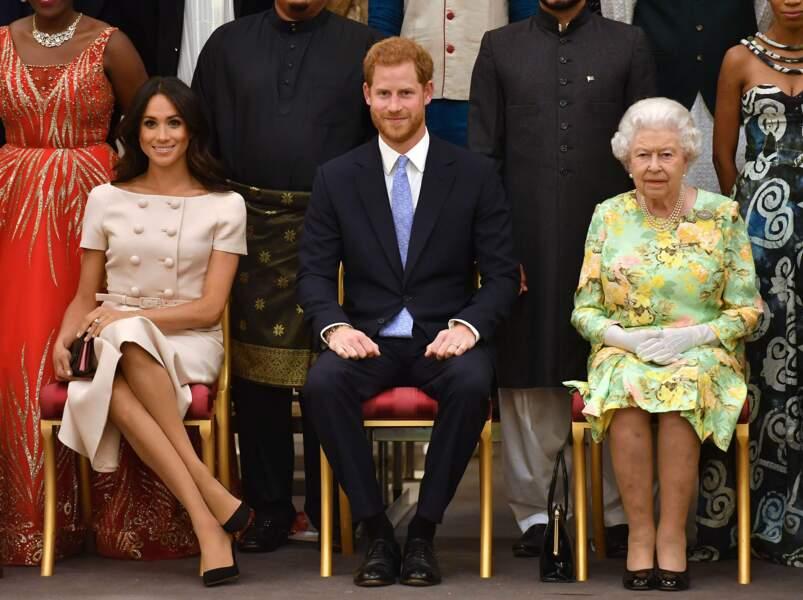 Harry entre les deux femmes de sa vie : Meghan et la reine Elizabeth II.