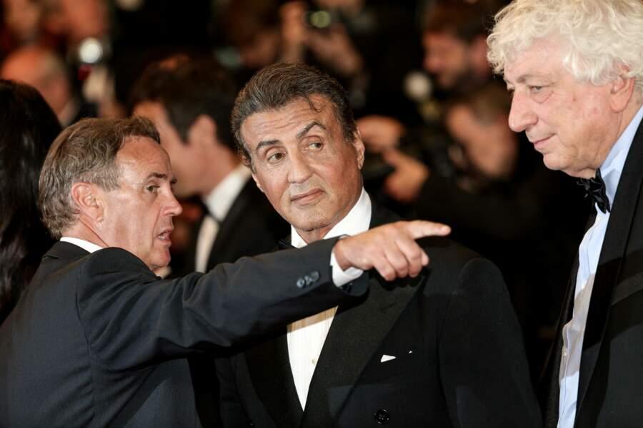 Sylvester Stallone arrive à la projection en son hommage