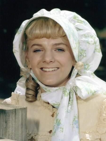 Nellie Oleson jouée par Alison Arngrim.