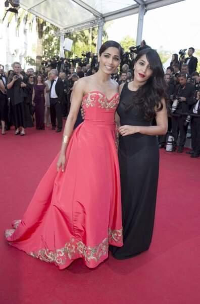 En rouge et noir... pour l'actrice indienne Freida Pinto et la Française Leila Bekhti