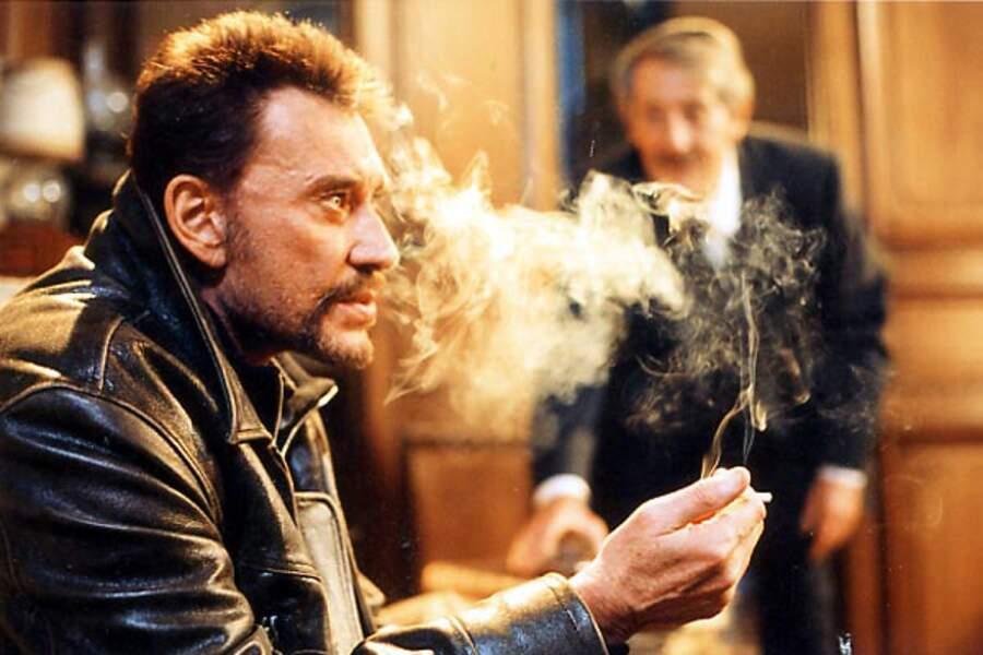 Face à Jean Rochefort dans L'homme du train (2003). Johnny, en voyageur taciturne, obtient le Prix Jean-Gabin