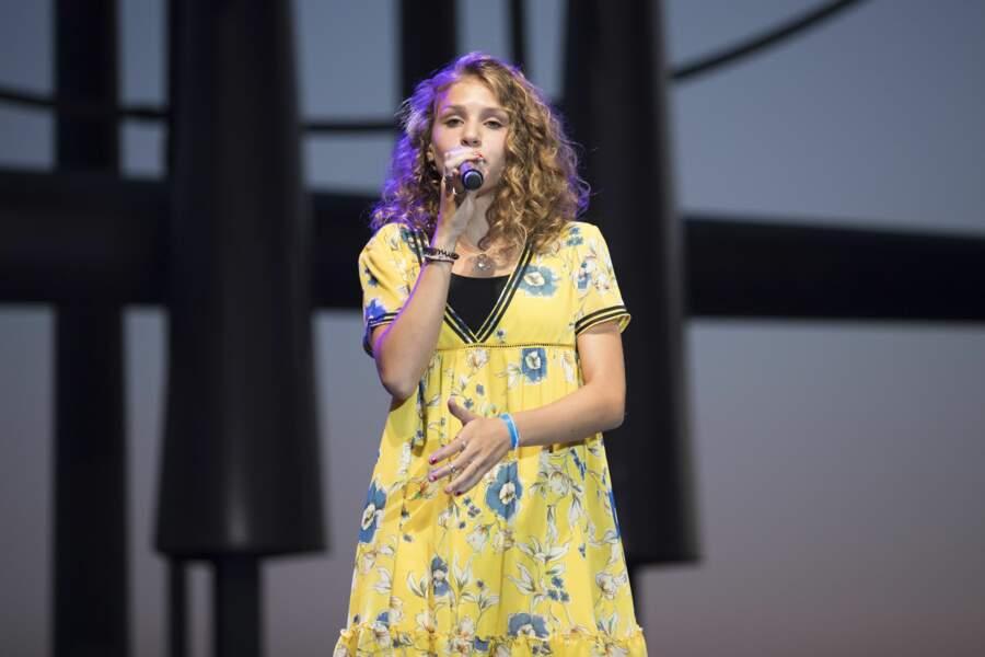 Lou a fait partie du casting de la troisième saison de The Voice Kids sur TF1