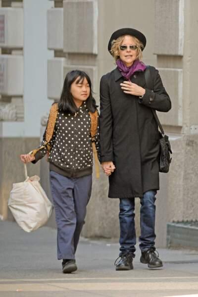 Avec sa fille Daisy dans le quartier de Soho à New-York