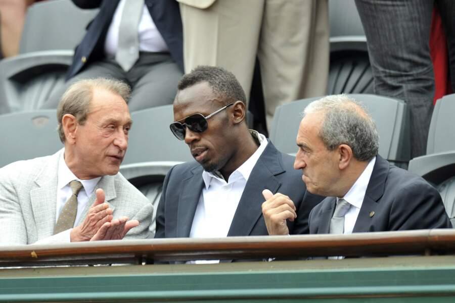 Bertrand Delanoë explique à Usain Bolt que les Velib' vont plus vite que lui.