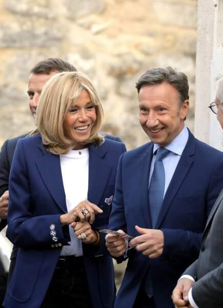Et de son épouse, la Première Dame, Brigitte Macron.