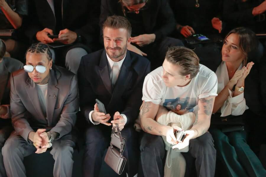 Tyga aux côtés de David, Brooklyn et Victoria Beckham au défilé Dior Homme