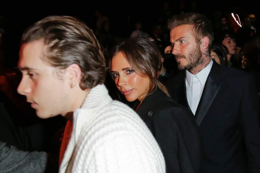 Brooklyn Beckham avec ses parents, Victoria et David Beckham, au défilé Dior Homme