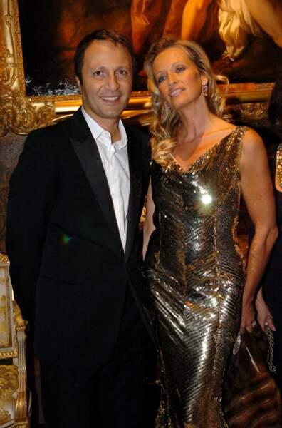 Papillon de lumière aux côtés de son ex-conjoint, Arthur, en 2004.