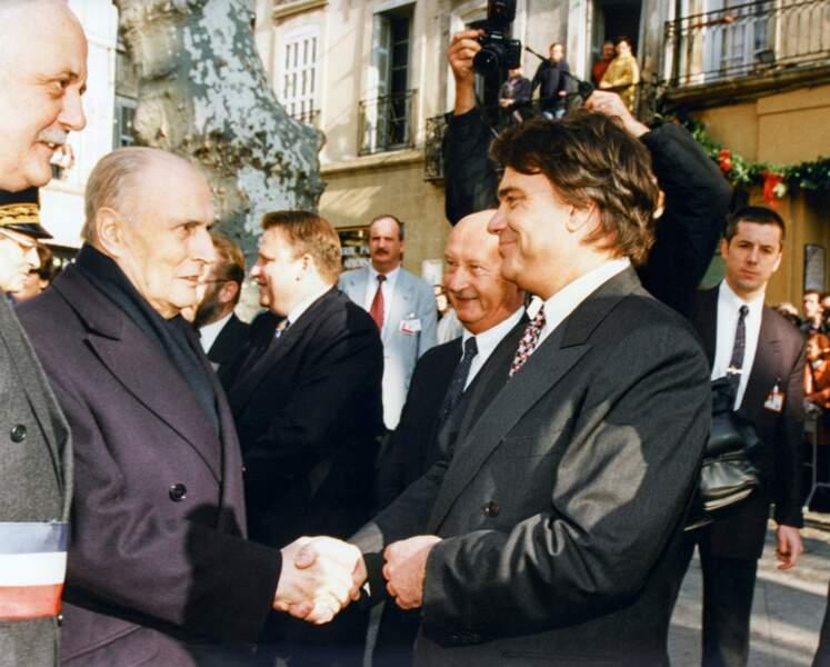 En parallèle, il s'engage en politique et François Mitterrand le nomme Ministre de la Ville