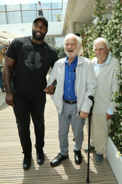 Teddy Riner qui a pris la pose avec Jean-Paul Belmondo et Charles Gérard