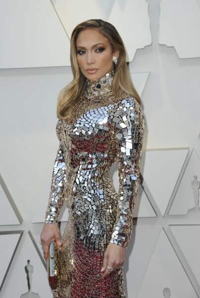 Aux derniers Oscars, Jennifer Lopez portrait une robe à effet miroir du créateur Tom Ford.