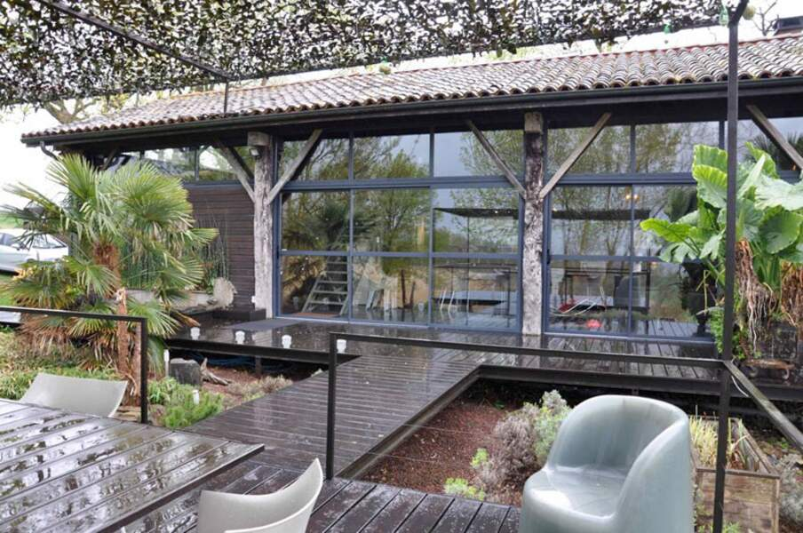 La Maison « Lodge recyclé » et sa terrasse