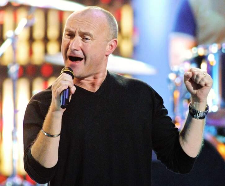 Phil Collins, poing levé en 2003
