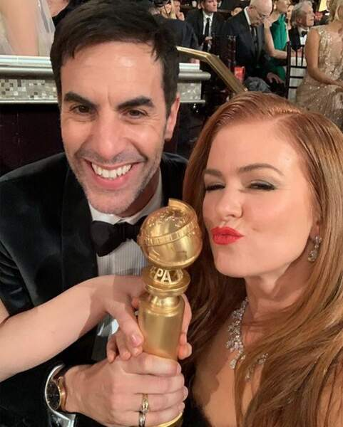 Reparti bredouille, Sacha Baron Cohen (ici avec sa femme Isla Fisher) tente de subtiliser un trophée !