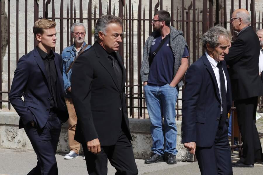 Mick Schumacher, l'ancien pilote Jean Alesi et Alain Prost à leur arrivée aux funérailles