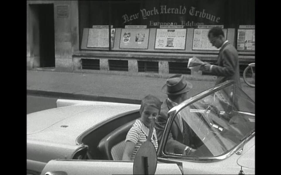 """Dans """"A bout de souffle"""", son premier long-métrage, Godard interprète un passant dénonçant Jean-Paul Belmondo."""