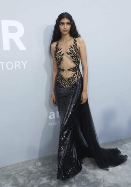 La mannequin brésilienne, Anita Pozzo avait elle aussi fait le choix d'une robe graphique, avec une sorte d'imprimé léopard recouvrant sa poitrine.