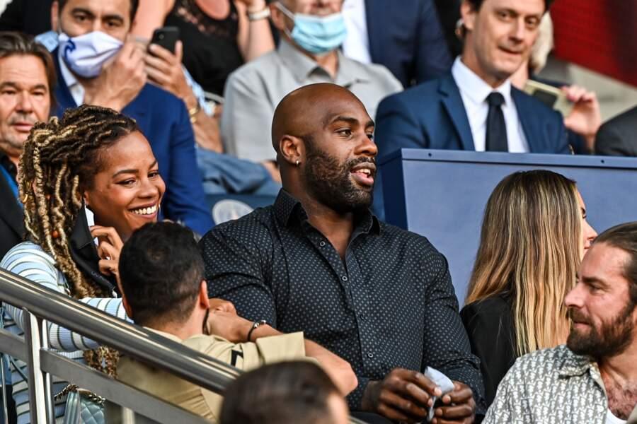 Teddy Riner et son épouse Luthna Plocus, tout sourire, pour accueillir Messi au Parc des Princes le 14 août 2021